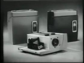 这部广告片让大家了解一下柯达300幻灯机......